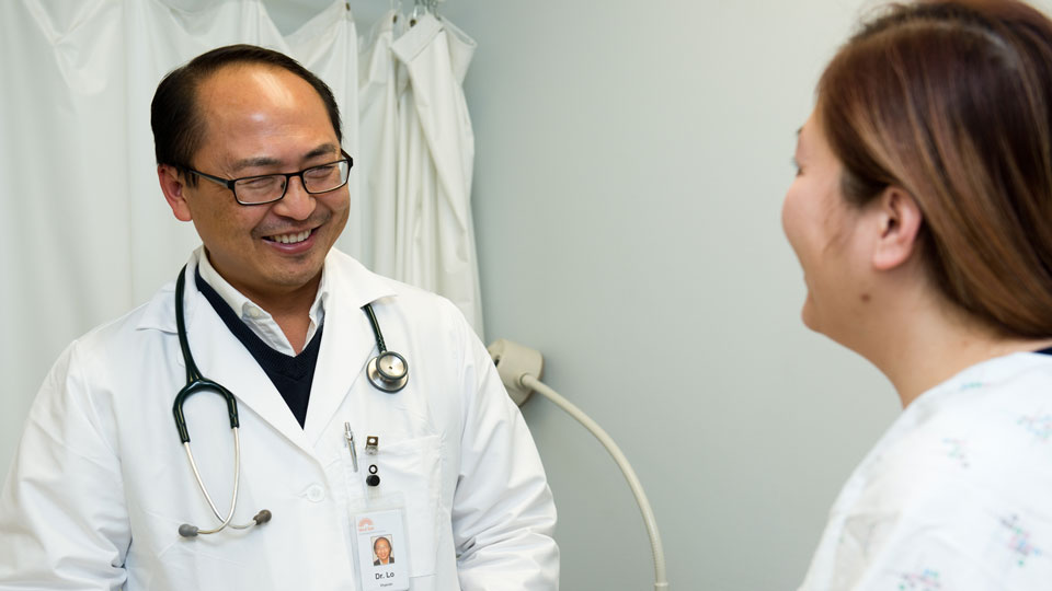 Hmong Doctor with patient St. Paul, MN
